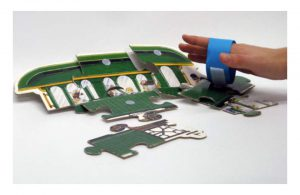 Velcro bracelet helps pick up puzzle pieces