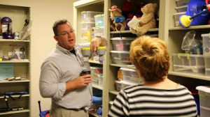 Volunteers search fabricATe's closet for parts.