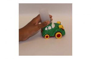 Toy car with old film canister attached for easy gripping