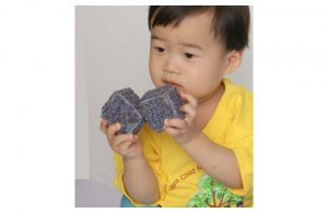 Example of child playing with textured blocks