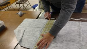 Measuring fabrics for constructing a garment protector.