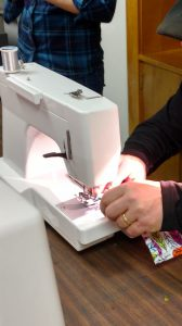 Sewing a garment protector.