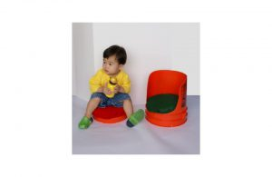 An example of a child using a barrel seat.